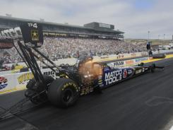 Antron Brown makes a run in Top Fuel, which he won with a time of 3.883 seconds at 314.61 mph.