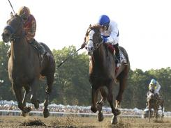Coil, left,  with Martin Garcia aboard, nudges out Shackelford to win the  $1 million Haskell Invitational Sunday.