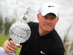 Simon Dyson of England shows off his prize after winning the Irish Open on Sunday at Killarney Golf and Fishing Club.