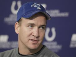 Peyton Manning, seen here in January, agreed to a five-year, $90 million contract with the hopes the Colts could spend more money on other players.