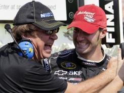 Paul Menard, right, is congratulated by his father, Johhn Menard after winning the Brickyard 400 Sunday at Indianapolis Motor Speedway.