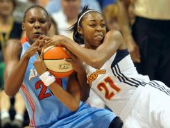 The Dream's Sancho Lyttle, left, and the Sun's Renee Montgomery fight over a loose ball during Connecticut's 99-92 win. Montgomery scored 19 points to lead the Sun.