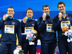 From left,  Nicholas Thoman, Mark Gangloff, Michael Phelps and Nathan Adrian led the USA to the gold medal in the men's 4x100 medley relay Sunday.