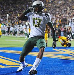 Cliff Harris returned a punt for a touchdown to help Oregon avoid an upset at California.