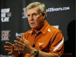 Texas football coach Mack Brown answers questions during Big 12 media day.