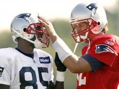"New Patriots wide receiver Chad Ochocino, left, visits with quarterback Tom Brady at training camp Saturday. Says Ochocino, ""He is the best at his craft. I've always called him a surgeon, and it's going to be fun being one of his patients."""