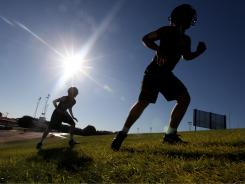 Football players from Plains High (Texas) work through a conditioning drill on the first day of practice.