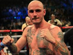 Kelly Pavlik celebrated after defeating Alfonso Lopez by majority decision last May. Tuesday he pulled out of a Saturday fight against Darryl Cunningham.