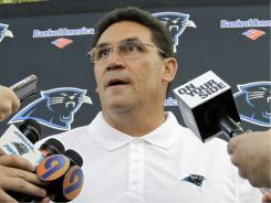 Carolina Panthers head coach Ron Rivera speaks to reporters at the beginning of the team's training camp in Spartanburg, S.C.
