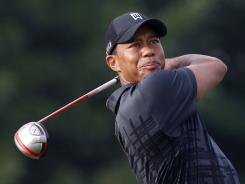 Tiger Woods hits his tee shot on the eighth hole during a practice round for the World Golf Championships: Bridgestone Invitational at Firestone Country Club on Tuesday in Akron, Ohio.