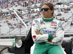 Simona De Silvestro, sitting in the pits at the Milwaukee Mile on June 19, sustained a head injury during qualifying the previous day. She raced 11 laps of the Milwaukee 225 before dropping out of the race.