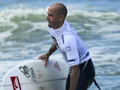 Kelly Slater leaves the sea after losing to countryman Bobby Martinez in round three of the Billabong Rio Pro surfing championship in Rio de Janeiro on May 19.