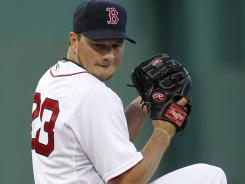 Red Sox starter Erik Bedard had no luck in his new duds, allowing three runs and seven hits in five innings in a loss to the Indians.