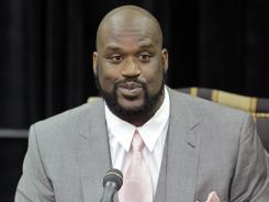 Shaquille O'Neal, seen here at his NBA retirement press conference in June,  is about to join the