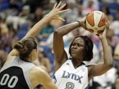 Minnesota Lynx forward Taj McWilliams-Franklin, right, scored 18 Thursday, including the game winner with 1.3 seconds left.