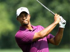 Tiger Woods eyes his approach on the sixth hole during the first round of the WGC-Bridgestone Invitational at Firestone Country Club on Thursday in Akron, Ohio.