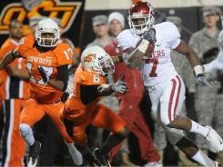 Running back DeMarco Murray, here against Oklahoma State in 2008, and Oklahoma will be looking for their ninth consecutive win in the series this upcoming season.