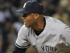Mariano Rivera closed out the ninth inning as the Yankees rallied for a 3-2 win over the rival Red Sox at Fenway Park in Boston on Friday.