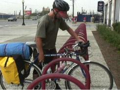 Darren O'Donnell, of Bellingham, Wash., locks up his bike at Nationals Park in Washington, D.C.