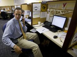 Alan Pandiani, 23, a sales consultant with the Aspire Group, makes ticket sales calls in the Fan Relationship Management Center at Georgia Tech.