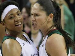 The Storm's Sue Bird, right, is grabbed by teammate Tanisha Wright after the former made a game-winning three-pointer to beat the Sun on Friday night.