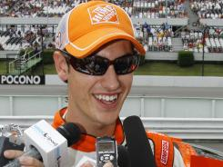 Joey Logano smiles as he talks with the media after qualifying for the pole position for Sunday's  Sprint Cup Series race at Pocono Raceway in Long Pond, Pa.