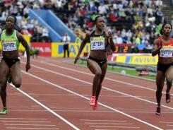 American Carmelita Jeter  (centre) wins the final of the women's 100 meters  during the Diamond League meet at Crystal Palace stadium in London on Saturday.