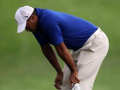 Tiger Woods shows his frustration Saturday during the third round of the World Golf Championships-Bridgestone Invitational at Firestone Country Club in Akron, Ohio.