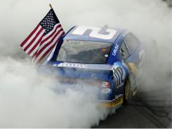 Brad Keselowski does a burnout after picking up his second Sprint Cup win of 2011.