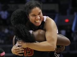 Connecticut Sun's Asjha Jones and Kara Lawson celebrate their overtime win against the Phoenix Mercury.