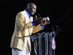 Deion Sanders addresses fans at the Hall of Fame enshrinement ceremony in Canton, Ohio.