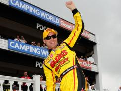 Kevin Harvick celebrates winning in victory lane after the NASCAR Camping World Truck Series Good Sam RV Emergency Road Service 125 at Pocono Raceway in Long Pond, Pa. Harvick had the pole position for the race.