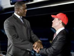Vice President of the Atlanta Hawks Dominique Wilkins, left, and new majority owner Alex Meruelo shake hands at the end of a news conference Monday in a Atlanta.