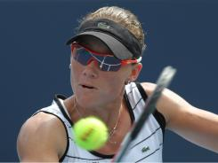 Samantha Stosur of Australia lines up a backhand during her victory Monday against Ayumi Morit, of Japan.