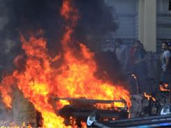 A car set on fire by rioters burns in Hackney, east London on Monday.