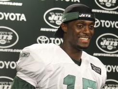 New York Jets wide receiver Plaxico Burress talks to the media after Sunday's practice in Florham Park, N.J.