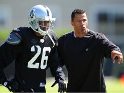Raiders cornerbacks coach Rod Woodson instructs Stanford Routt during practice last week in Napa, Calif.