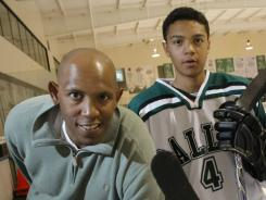 Seth Jones, right, began playing when his dad Popeye played for the Denver Nuggets.