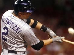 Troy Tulowitzki's two-run homer was one of only five Rockies' hits Tuesday but Colorado still managed a 3-2 win over the  Reds.