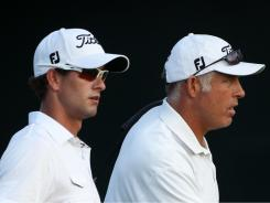 Scott of Australia and caddie Steve Williams work a practice round Tuesday at the PGA Championship.