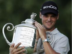 Martin Kaymer of Germany holds the Wanamaker Trophy after winning the 2010 PGA Championship.