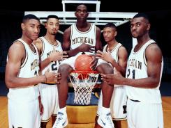 Jimmy King, left, was arrested Wednesday on accusations of failing to pay child support. King was a college basketball star in Michigan's Fab Five, as well as a professional player for the Toronto Raptors.