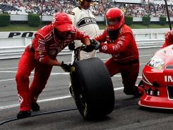 A tire changer for Juan Pablo Montoya and an Earnhardt Ganassi mechanic were fired by the team after being charged with drug trafficking.