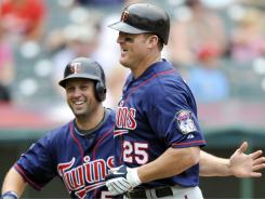Twins' Jim Thome, right, is congratulated by teammate Michael Cuddyer.
