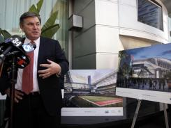 Tim Leiweke, president and CEO of Anschutz Entertainment Group, speaks to reporters, in Los Angeles on Tuesday The Los Angeles City Council voted 12-0 Tuesday in favor on a framework deal on the funding and timeline for a proposed 72,000-seat NFL football stadium.
