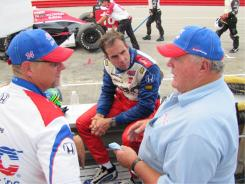 A.J. Foyt, right, confers with his driver Vitor Meira, center, and the ABC Supply Crew before Sunday's Honda Indy 200 at Mid-Ohio.