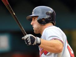 Dan Uggla extended his hit streak to 31 consecutive games despite only managing a .221 batting average.