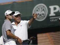 Adam Scott talks to caddie Steve Williams during a practice round Wednesday at the Atlanta Athletic Club.