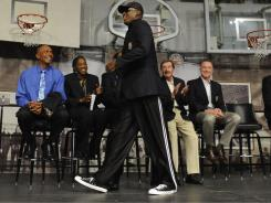 Dennis Rodman walks past fellow inductees into the Basketball Hall of Fame during a news conference Thursday.
