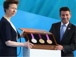 Anne and LOCOG Chairman Sebastian Coe present the Olympic medals during  the London 2012 One Year To Go ceremony in Trafalgar Square on July 27.